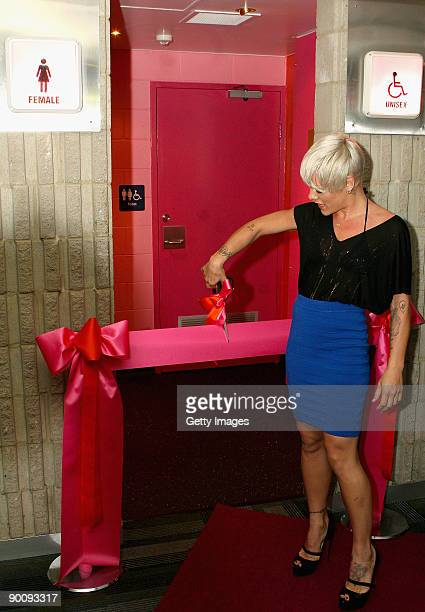 """Singer Pink cuts the ribbon to officially open the door 6 female toilet block at the Brisbane Entertainment Centre which has been named """"Pink Ladies""""..."""