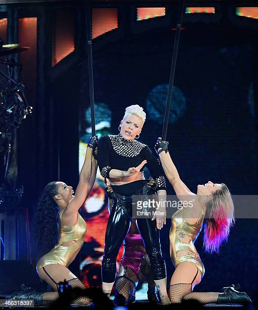 Singer Pink performs with dancers at the MGM Grand Garden Arena during The Truth About Love tour on January 31 2014 in Las Vegas Nevada
