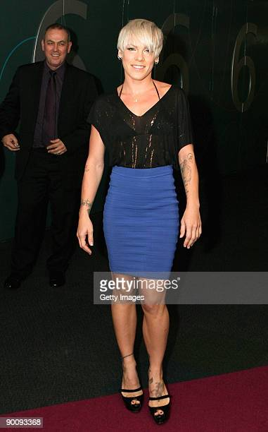 """Singer Pink poses outside the door 6 female toilet block at the Brisbane Entertainment Centre which has been named """"Pink Ladies"""" in honour of her for..."""