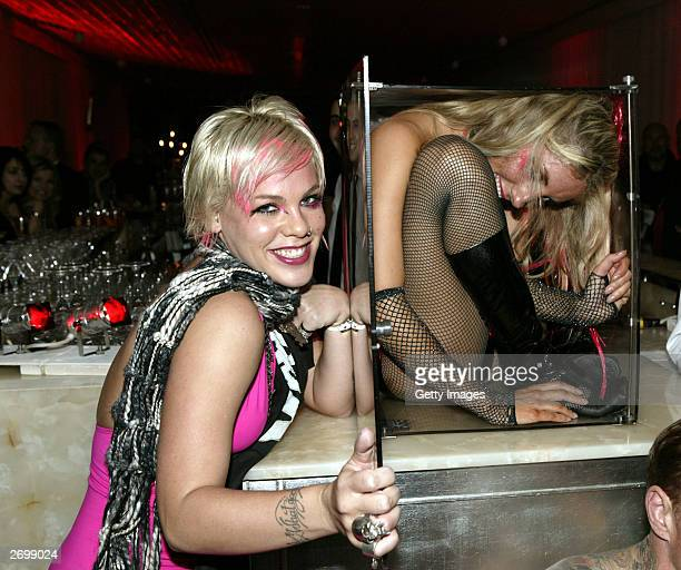 Singer Pink with contortionist Delia Du Sol attend the aftershow party for the launch of Pink's new album Try This at the Sanderson Hotel on November...
