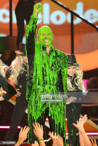 Singer Pitbull performs onstage during Nickelodeon's 26th Annual Kids' Choice Awards at USC Galen Center on March 23 2013 in Los Angeles California
