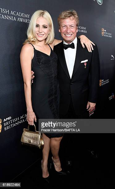 Singer Pixie Lott and director Nigel Lythgoe attend the 2016 AMD British Academy Britannia Awards presented by Jaguar Land Rover and American...