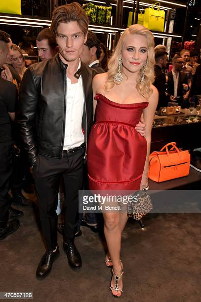 Singer Pixie Lott and Oliver Cheschire attend the DSQUARED2 celebration of London Flagship Opening on April 21 2015 in London England