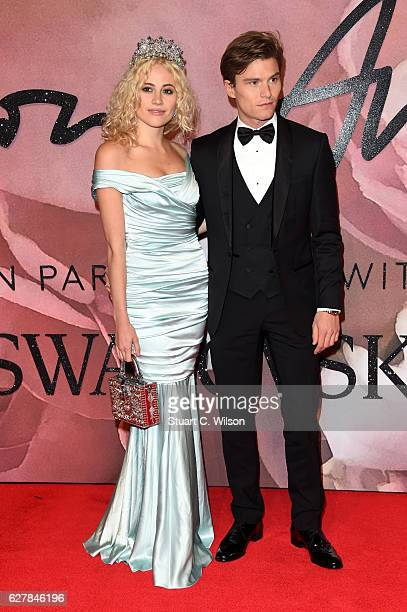Singer Pixie Lott and Oliver Cheshire attend The Fashion Awards 2016 on December 5 2016 in London United Kingdom