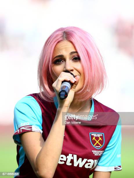 Singer Pixie Lott performs during halftime in the Premier League match between West Ham United and Everton at London Stadium on April 22 2017 in...
