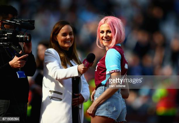 Singer Pixie Lott smiles as she performs during the Premier League match between West Ham United and Everton at the London Stadium on April 22 2017...
