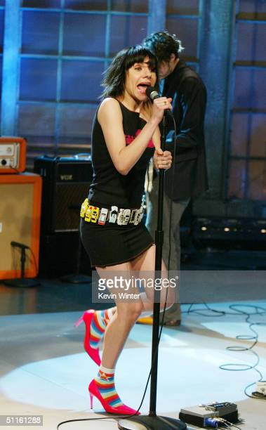 Singer PJ Harvey performs on The Tonight Show with Jay Leno on August 11 2004 at the NBC Studios in Burbank California