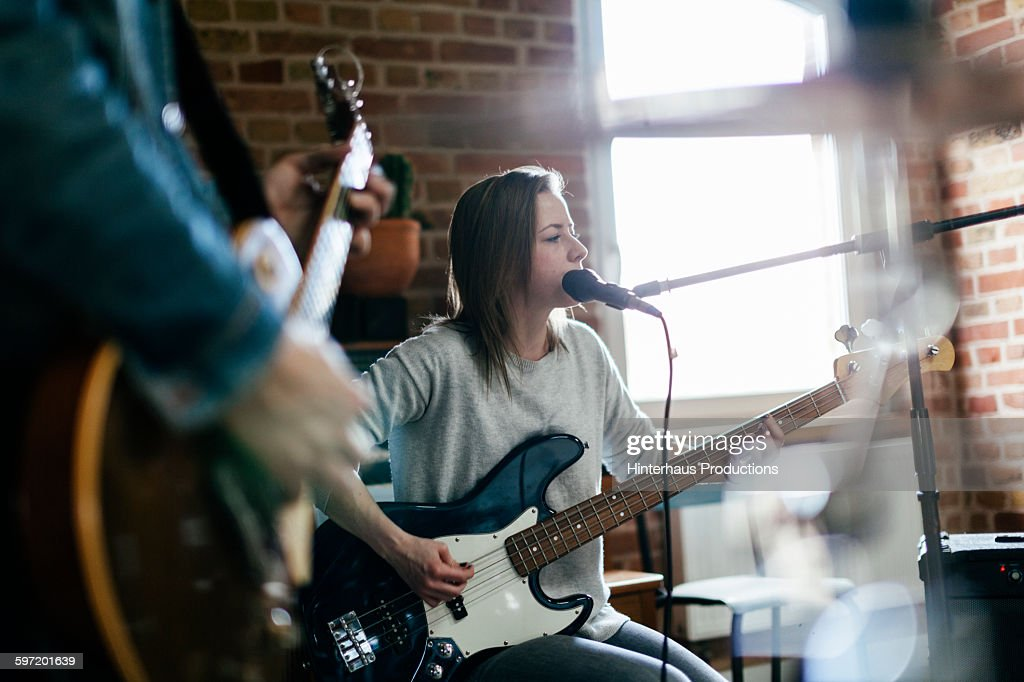 Singer playing guitar and performing a song : Stock Photo