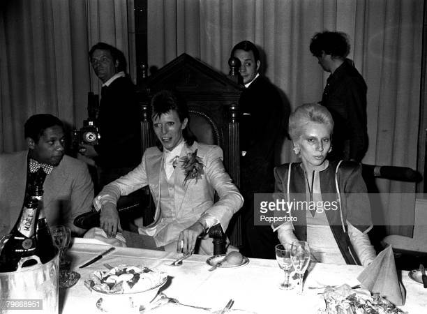 Singer, Pop star David Bowie and his wife Angie at a party given by Bowie at the Cafe Royal following his last public concert at the Odeon Theatre,...