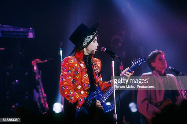 Singer Prince and guitarist Wendy Melvoin, of the band Prince and the Revolution, performing on stage at the Theatre de Verdure for the shooting of a...