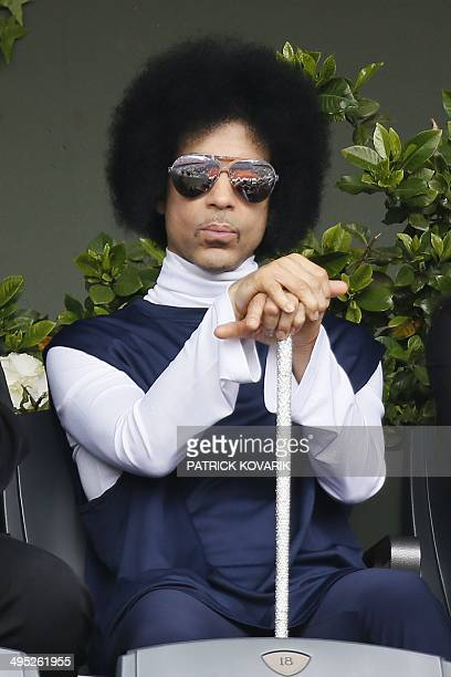 US singer Prince attends the French tennis Open round of sixteen match between Spain's Rafael Nadal and Serbia's Dusan Lajovic at the Roland Garros...