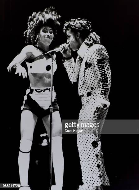 Singer Prince performs with dancer on stage during Wembley Arena concert in London 1988