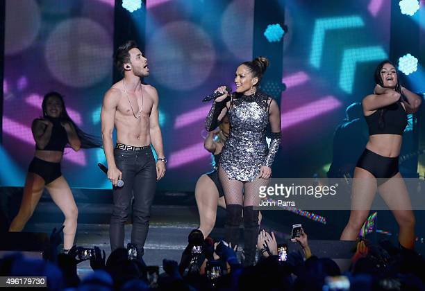 Singer Prince Royce and Jennifer Lopez perform onstage at iHeartRadio Fiesta Latina presented by Sprint at American Airlines Arena on November 7 2015...