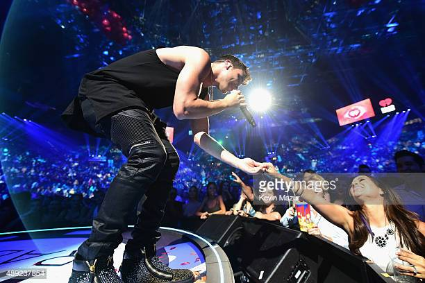 Singer Prince Royce performs onstage at the 2015 iHeartRadio Music Festival at MGM Grand Garden Arena on September 19 2015 in Las Vegas Nevada