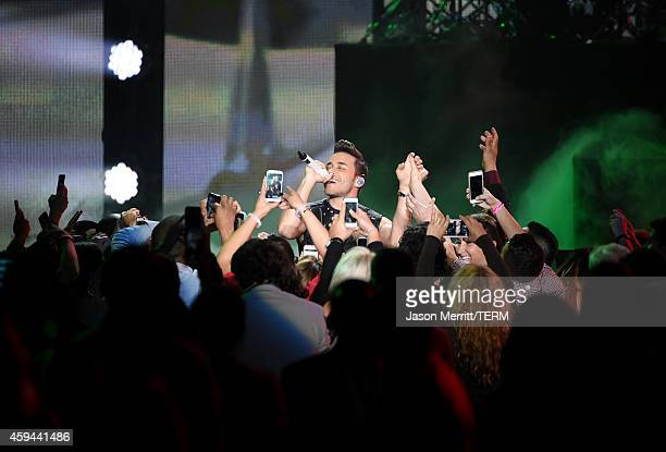 Singer Prince Royce performs onstage during the iHeartRadio Fiesta Latina festival presented by Sprint at The Forum on November 22 2014 in Inglewood...