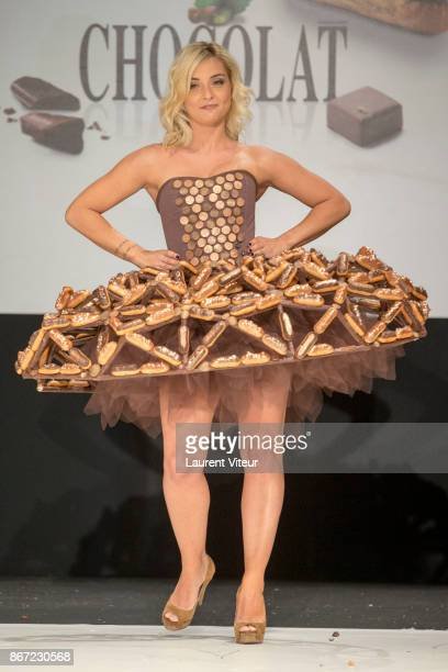 Singer Priscilla Betti walks the Runway during Le Defile des Robes en Chocolats during the Salon du Chocolat Paris 2017 at Parc des Expositions Porte...