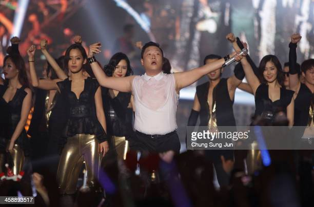 Singer PSY performs on stage during '2013 PSY Concert All Night Stand' at Olympic Stadium at Olympic Stadium on December 22 2013 in Seoul South Korea