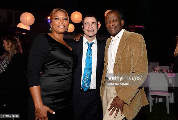 Singer Queen Latifah actors John Travolta and Sidney Poitier attend the 87th birthday celebration of Tony Bennett and fundraiser for Exploring the...