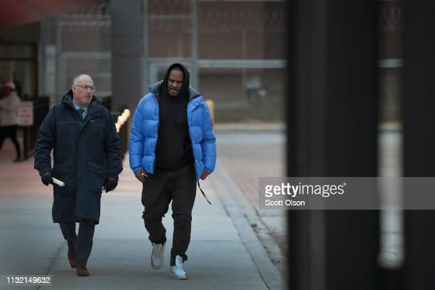 B singer R Kelly and his attorney Steve Greenberg leave Cook County jail after Kelly posted $100 thousand bond on February 25 2019 in Chicago...