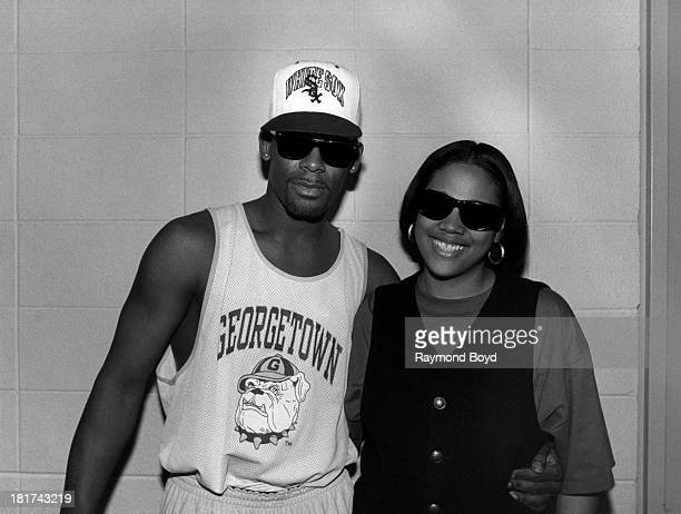 Singer R Kelly and rapper and radio personality Monie Love poses for photos backstage at the Arie Crown Theater in Chicago Illinois in MAY 1993