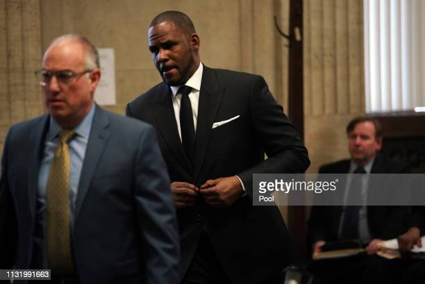 Singer R Kelly appears in court with his attorney Steve Greenberg for a hearing to request that he be allowed to travel to Dubai at the Leighton...