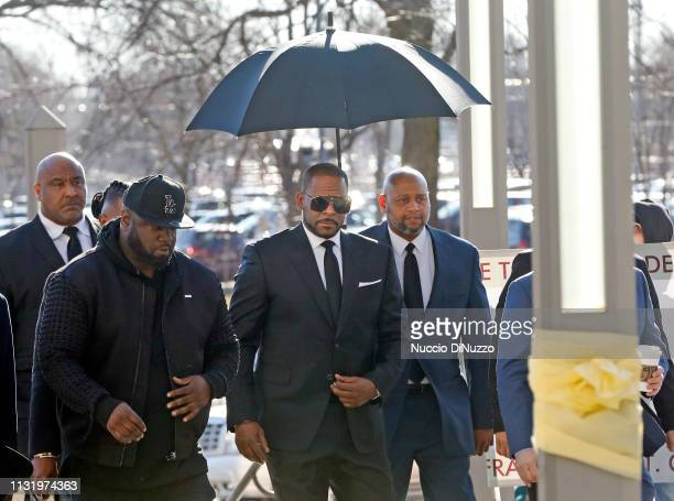 Singer R Kelly arrives for his court date at the Leighton Courthouse on March 22 2019 in Chicago Illinois R Kelly appeared before a judge to request...