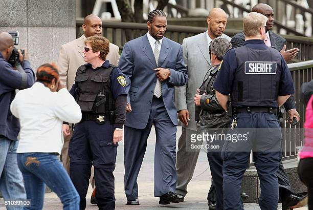 B singer R Kelly leaves the Cook County courthouse where jury selection is underway for his child pornography trial May 9 2008 in Chicago Illinois...