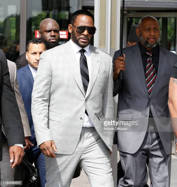 Singer R Kelly leaves the Leighton Criminal Courthouse on June 06 2019 in Chicago Illinois The singer appeared in front of a judge to face new...