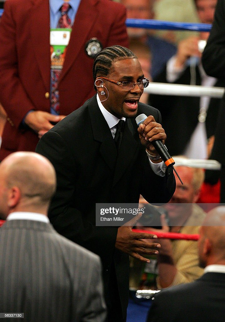 Singer R. Kelly performs his version of the national anthem before the Bernard Hopkins and Jermain Taylor undisputed world middleweight championship fight at the Mandalay Bay Events Center on December 2, 2005 in Las Vegas, Nevada.