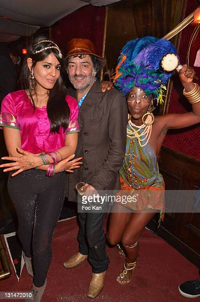 Singer Rachid Taha and two guests attend Le Baron 7th Anniversary at Le Baron Club on November 4 2011 in Paris France