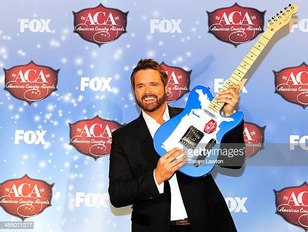 Singer Randy Houser poses in th press room during the American Country Awards 2013 at the Mandalay Bay Events Center on December 10, 2013 in Las...