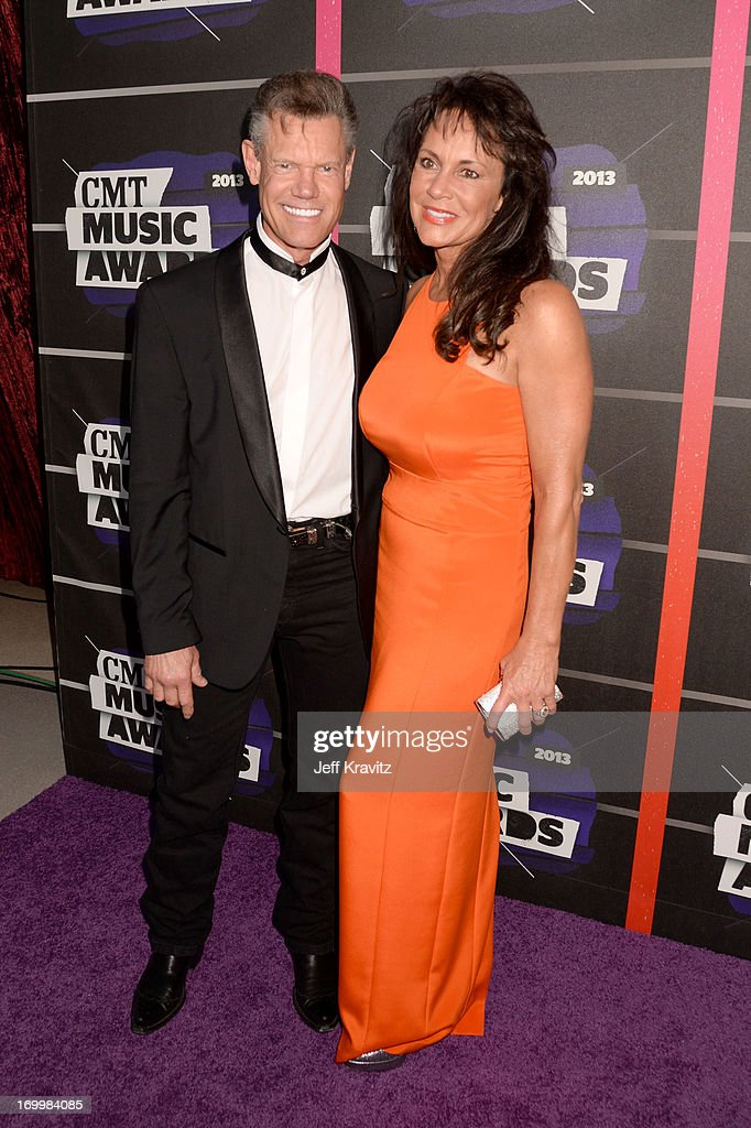 Singer Randy Travis and Mary Beougher arrive at the 2013 CMT Music Awards at the Bridgestone Arena on June 5, 2013 in Nashville, Tennessee.