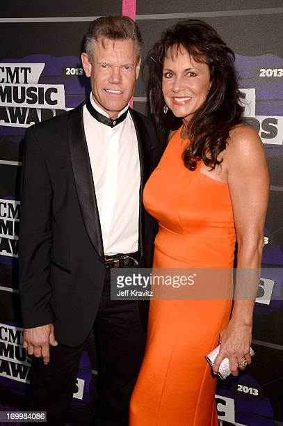 Singer Randy Travis and Mary Beougher arrive at the 2013 CMT Music Awards at the Bridgestone Arena on June 5 2013 in Nashville Tennessee