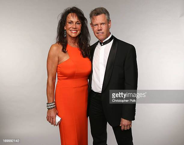 Singer Randy Travis and Mary Beougher pose at the Wonderwall portrait studio during the 2013 CMT Music Awards at Bridgestone Arena on June 5 2013 in...
