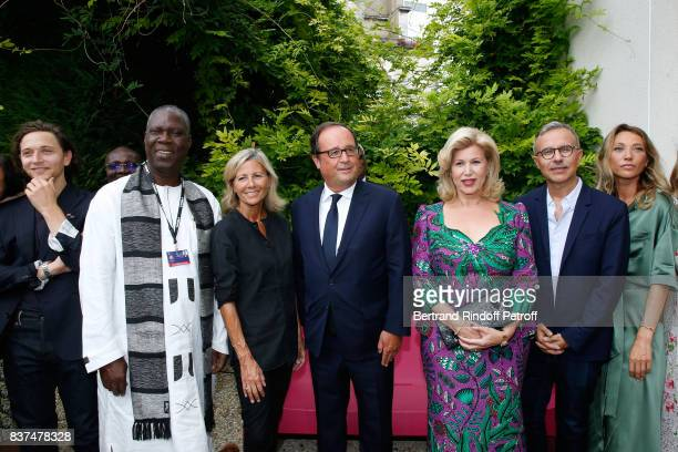 Singer Raphael Minister of Culture of Cote d'Ivoire Maurice Kouakou Bandaman journalist Claire Chazal Former French President Francois Hollande First...
