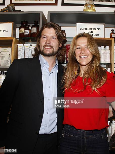 Singer Ray Garvey and actress Alexandra Neldel attend the Kiehl's 'Take Care' Charity event at the Berlin Kiehl store on July 1 2011 in Berlin Germany