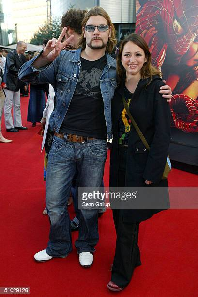 """Singer Reamonn Garvey and friend Josephine attend the German premiere of """"Spider-Man 2"""" at the Sony Center on July 6, 2004 in Berlin, Germany."""
