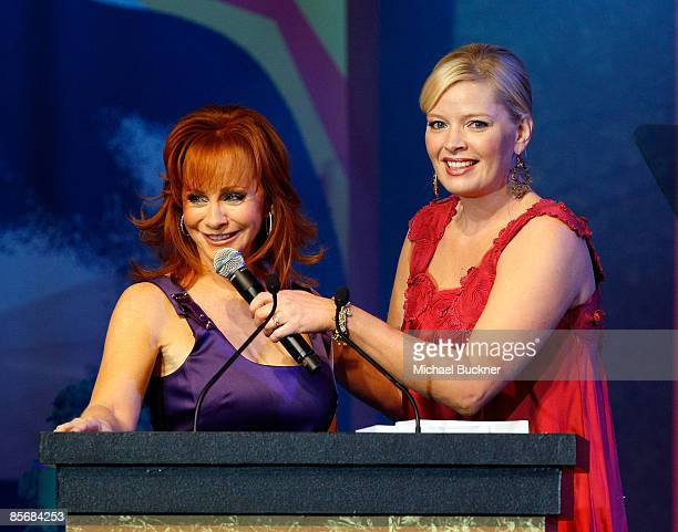 Singer Reba McEntire and actress Melissa Peterman onstage during Muhammad Ali's Celebrity Fight Night XV held at the JW Marriott Desert Ridge Resort...