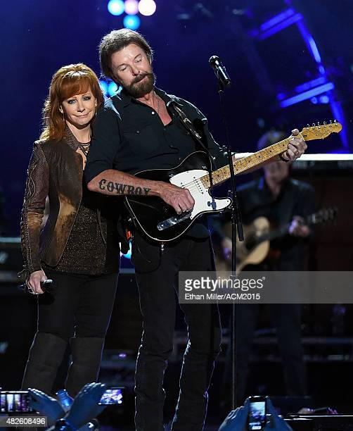 Singer Reba McEntire and recording artist Ronnie Dunn of Brooks Dunn perform during ACM Presents Superstar Duets at Globe Life Park in Arlington on...