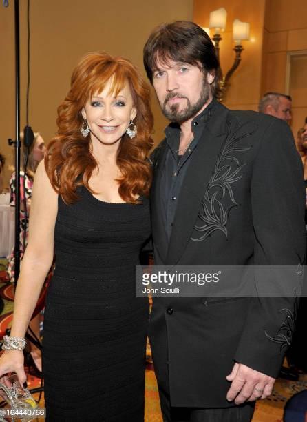 Singer Reba McEntire and Singer Billy Ray Cyrus attend Muhammad Ali's Celebrity Fight Night XIX at JW Marriott Desert Ridge Resort & Spa on March 23,...
