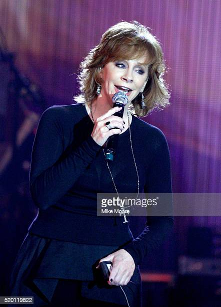 Singer Reba McEntire performs onstage during Muhammad Ali's Celebrity Fight Night XXII at the JW Marriott Phoenix Desert Ridge Resort Spa on April 8...