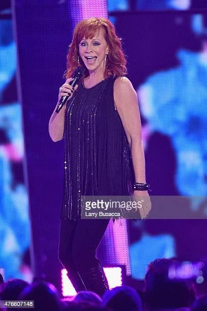 Singer Reba McEntire performs onstage during the 2015 CMT Music awards at the Bridgestone Arena on June 10 2015 in Nashville Tennessee