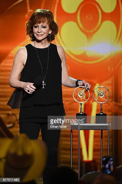 Singer Reba McEntire presents awards onstage during the 2016 American Country Countdown Awards at The Forum on May 1 2016 in Inglewood California