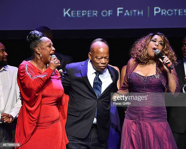 Singer Regina Belle US Rep John Lewis and singer Jennifer Holliday onstage at John Lewis 75th Birthday Celebration at The Tabernacle on March 28 2015...