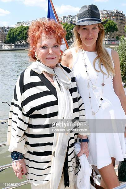 Singer Regine and Eva Dichand attend 'Brunch Blanc' hosted by Groupe Barriere for Sodexho with a cruise in Paris on June 30 France