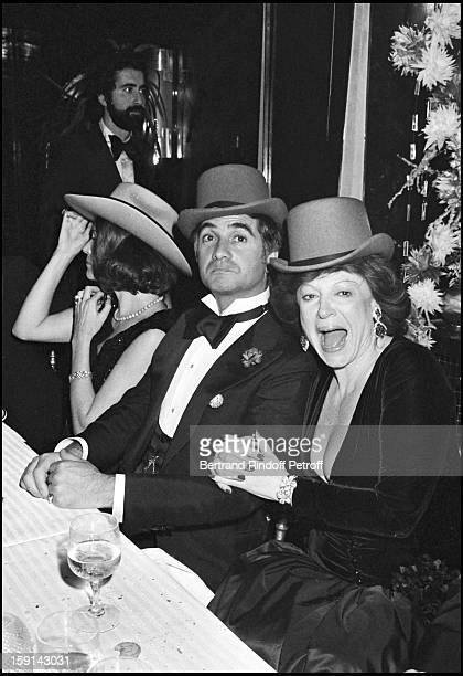 Singer Regine and JeanClaude Brialy celebrate new year's eve with singer Carlos at Regine's night club in Paris in 1977
