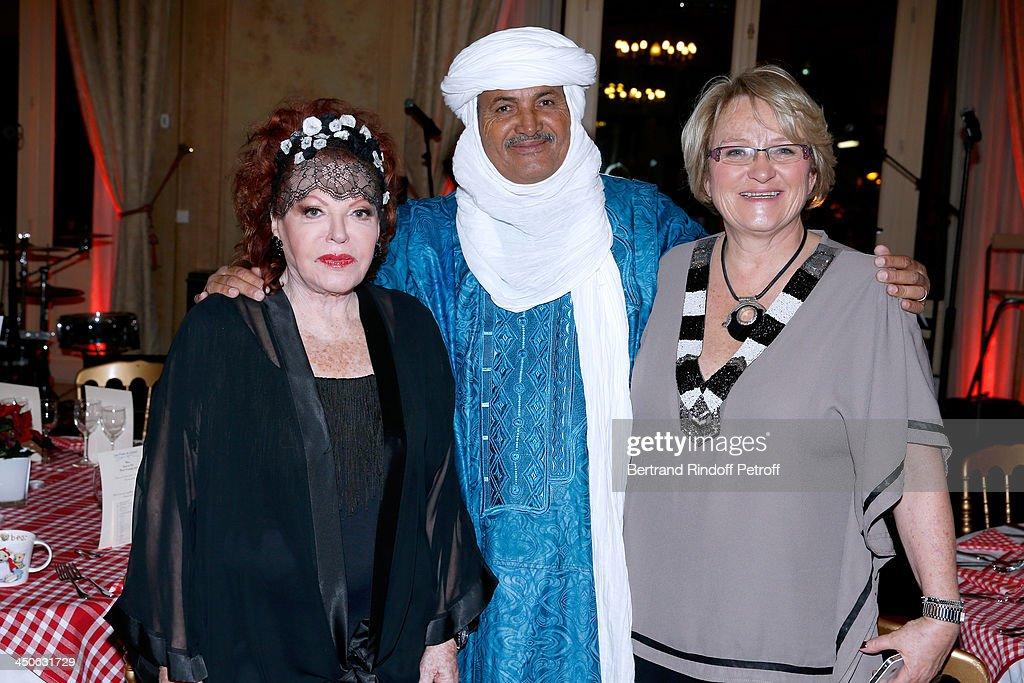 Singer Regine, CEO of O.N.G. 'Tidene' Mohamed Ixa and CEO of O.N.G. 'Les Puits du Desert' Christel Pernet attend 'Les Puits du Desert' Charity Gala at Cercle des Armees on November 19, 2013 in Paris, France.