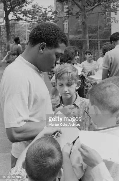 Singer Renaldo 'Obie' Benson of American vocal group the Four Tops signing autographs at a sports event in New York City 1965