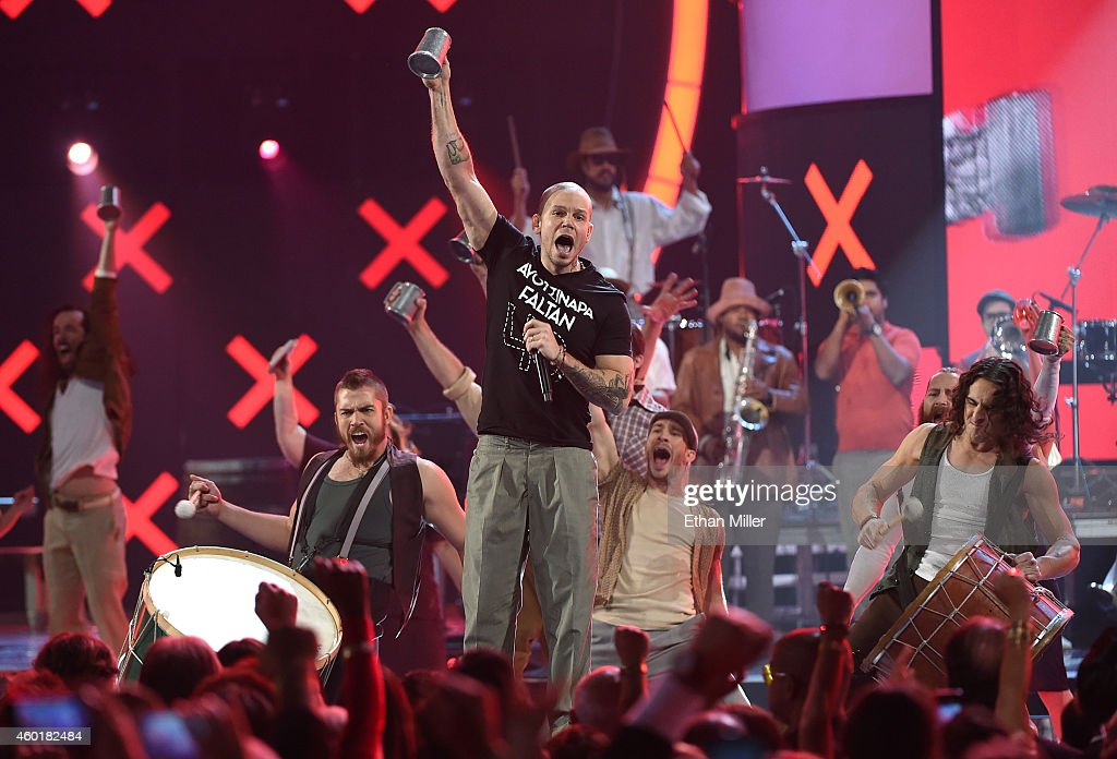 Singer Rene Perez Joglar (C) of Calle 13 performs during the 15th annual Latin GRAMMY Awards at the MGM Grand Garden Arena on November 20, 2014 in Las Vegas, Nevada.