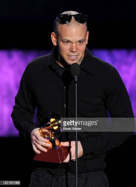 Singer Residente of Calle 13 accepts the Best Tropical Song award onstage during the 12th annual Latin GRAMMY Awards pretelecast at the Mandalay Bay...